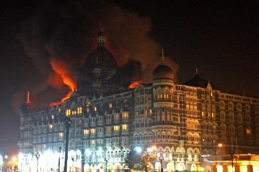 Taj Mahal Palace Hotel in Mumbai burning
