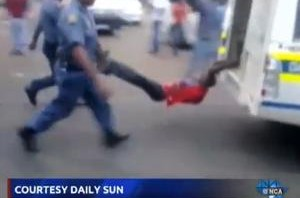 Police Brutality – watch video of SAPS police officer dragging Taxi driver at back of Bakkie