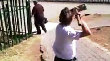 Pupil attacking teacher with broom