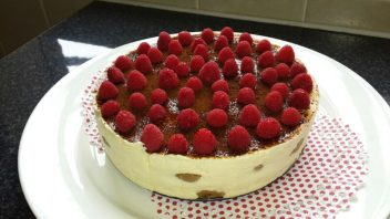 Tiramisu Cheesecake with Coffee Glaze and Raspberry Topping by Bibi Fathima Sirkhot